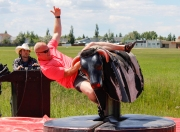 Kevin Pennyfeather Rep Staff Jason Flewell tried his luck wrangling a mechanical bull at the Daystar Church Father's Day Bash on June 18.