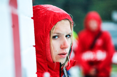 Kevin Pennyfeather/Rep staff Brielle Johnson, a lifeguard/instructor at Alexandra Outdoor Pool, calmly waited in the rain before the annual Lifeguards vs. Public water gun showdown on July 11.